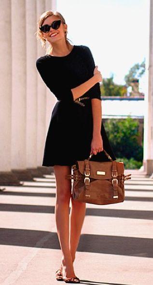 Simple black dress, brown belt, cat eye sunglasses, brown bag.