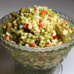 This here is pea salad!   1can peas,1 can corn, 1 can green beans, 1 jar pimentos1 cup chopped celery 1/2 cup chopped green bell pepper 1/2 cup onion 1cup white sugar 1/2 teasp pepper 1teasp salt 1/2 cup oil 3/4 cup white wine vinegar Mix together In a saucepan over medium heat, combine the sugar, black pepper, salt, oil and vinegar. Bring to a boil and pour over salad; mix well to coat. Refrigerate for 24 hours.
