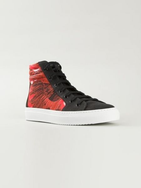 Black+and+red+cotton+printed+hi-top+sneakers+from+Marcelo+Burlon+County+Of+Milan+featuring+an+almond+toe,+a+lace-up+front+fastening,+a+brand+embossed+tongue+and+a+white+rubber+sole. http://rfbd.cm/rp93c308f2
