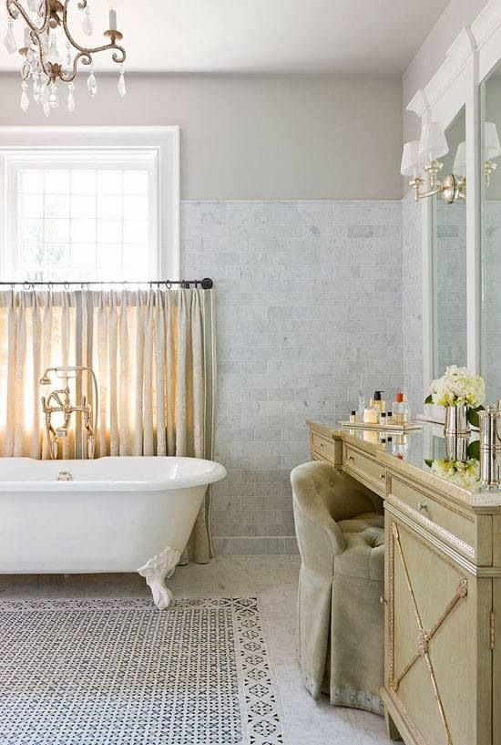 Independent bath stand with gold taps and low hung curtains for privacy and yet romantic feel.