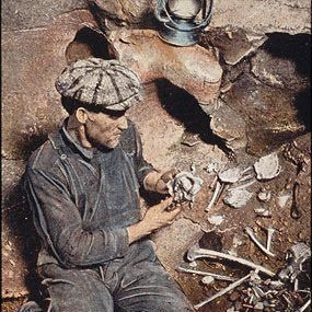 Floyd Collins showing off fossils and bones found while caving.