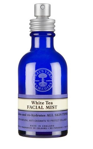 Neal's Yard Remedies White Tea Facial Mist is a must to set your mineral foundation. Also mist to counteract the drying effect of plane travel.