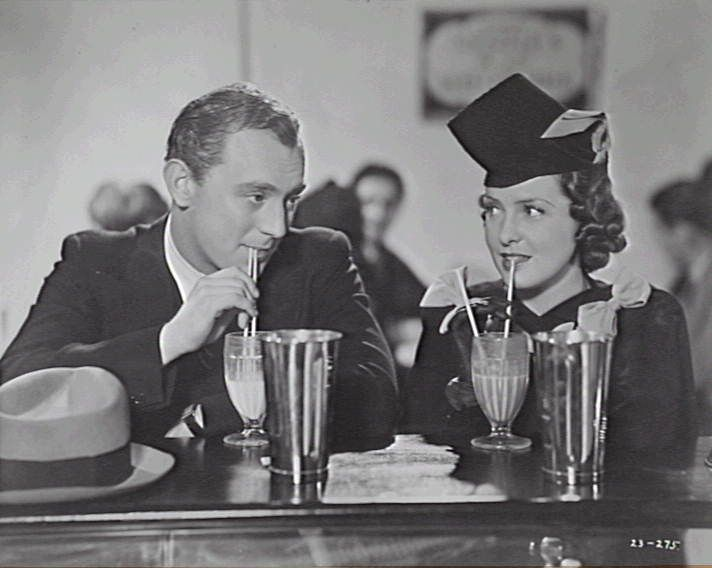 DAD AND DAVE COME TO TOWN : AT MILK BAR; BILLY RAYS (JIM BRADLEY) AND SHIRLEY ANN RICHARD (JILL) BOTH SIPPING ON MILK SHAKES AND LOOKING INTO EACH OTHERS EYES