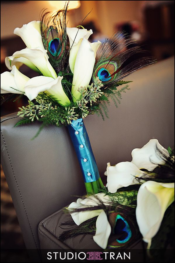 White Calla Lily wedding bouquet with peacock feathers #bridalbouquet #weddingflowers