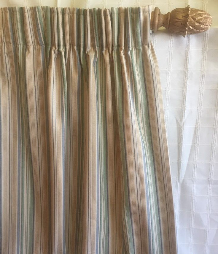 Subtle Stripes. Two curtains in this striped fabric, cover a track of 244 cms and measure 210cms long. I'm loving that soft green with the blue.