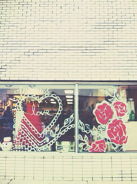 Valentines day window drawing with car window paint ...