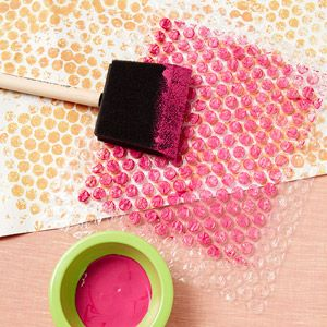Painted bubble wrap! They're saying that you can do this as a bouquet wrap for Valentine's Day... but it would be neat just to send a package that has an item wrapped up in painted bubble wrap. Among other things. Candles?
