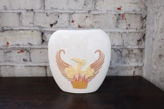 Check out this item in my Etsy shop https://www.etsy.com/listing/497469830/southwestern-vase-bird-phoenix-fire