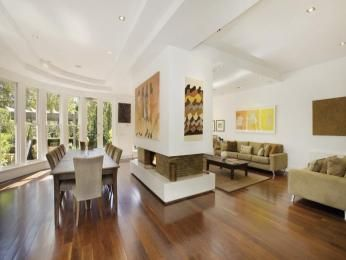 Modern dining room idea with floorboards & fireplace - Dining Room Photo 414024