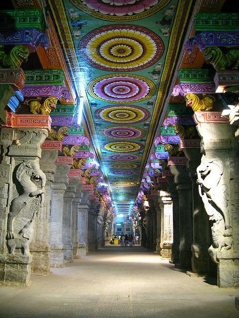 Meenakshi Amman Temple is a historic Hindu temple located on the southern bank of river Vaigai in the temple city of Madurai, Tamil Nadu, India. Photo by robotsergio via Flickr.
