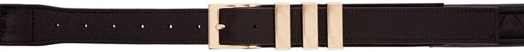 Quilted leather belt in black. Adjustable pin-buckle fastening. Gold-tone hardware. Tonal stitching.