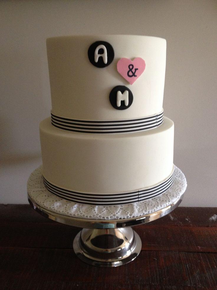 2 tiered Engagement/ Wedding cake.  Top tier is rainbow, bottom tier is chocolate mudcake.