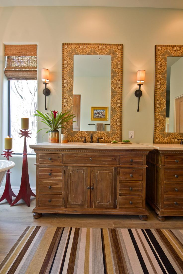 Southwest bathroom vanities - Decorative Southwestern Tile Frames The Mirrors Above The Furniture Style Vanities In This Gorgeous Bathroom