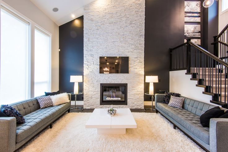 stacked stone fireplaces in Living Room Contemporary with carpeted stairs black wall