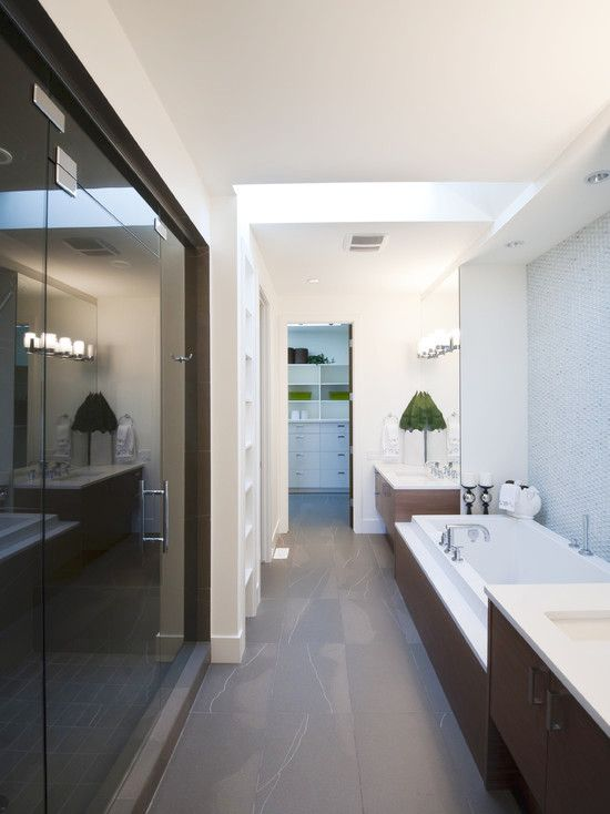 Long #modern #bathroom #design leading to a large walk-in #closet