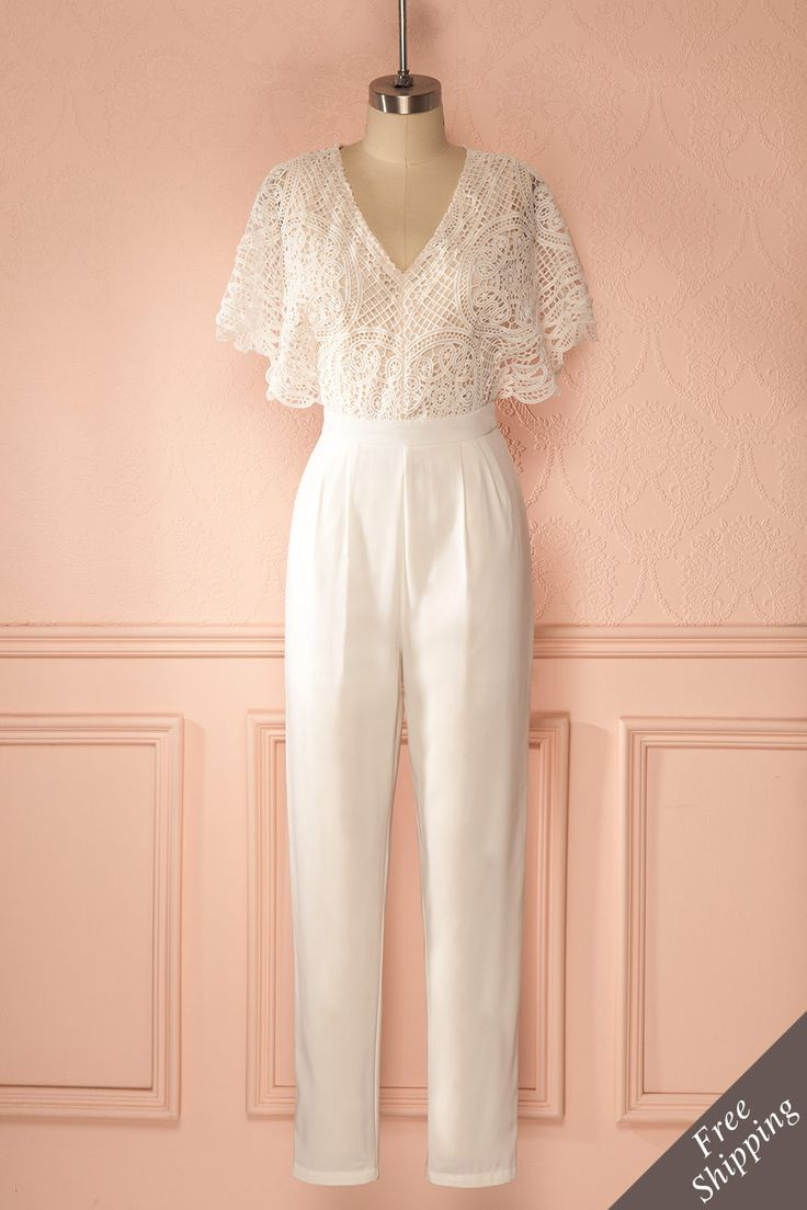 On entendit le bruissement léger des ailes d'un papillon.  We heard the subtle rustle of wings of a butterfly.  Ivory lace bust jumpsuit  http://1861.ca/products/caesarie