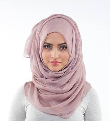 Shayla;  another style of hijab, the shayla is a long, rectangular scarf popular in the Gulf region. It is wrapped around the head and tucked or pinned in place at the shoulders.