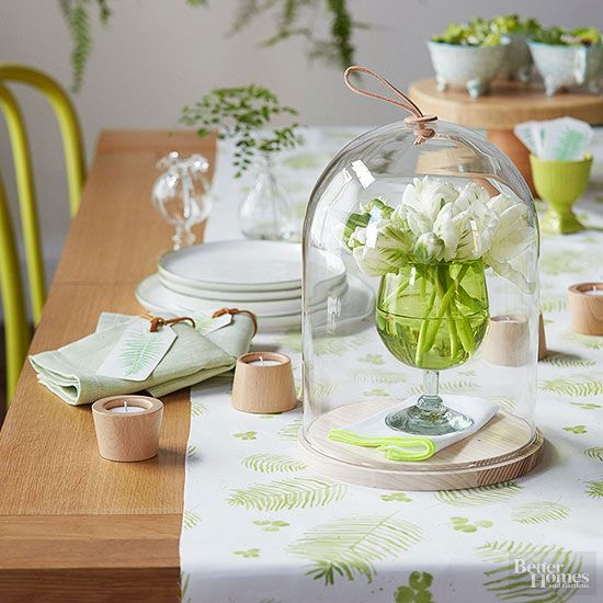Give your Easter soiree a healthy dose of spring fever with season-appropriate colors and motifs. Combine vibrant greens and clean whites with the beige-browns found in light-tone woods and leather. Fern-motif stamps make it easy to add a detailed frond to tags and napkins; a gathering of pretty posies under a glass cloche makes an impressive centerpiece./