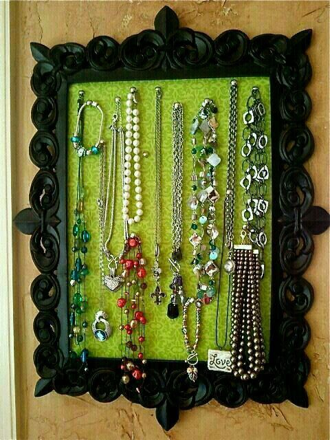 Great idea to hang your little ones play jewelry. Maybe a purple frame with a pink glitter background. Use cardboard and tack hooks to hold jewelry.  G;)
