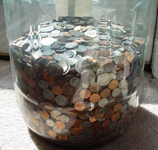 Keep all your spare change in a jar, and on Christmas, leave it at the door of someone who could use it.