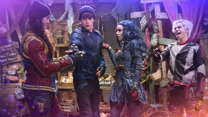 Mitchell Hope as King Ben Booboo Stewart as Jay Cameron Boyce as Carlos and Sofia Carson as Evie in the song featuring in Descendants 2 Chillin' Like A Villain