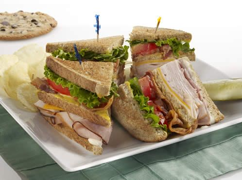 McAlister's Club™-McAlister's Deli- Butterball™ smoked turkey, Black Forest ham, applewood smoked bacon, sharp cheddar, Swiss, lettuce, tomatoes, McAlister's Honey Mustard™ and lite mayo on sliced wheat bread.