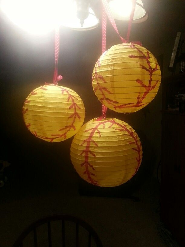 Paper laterns with painted stitches to make them into softballs