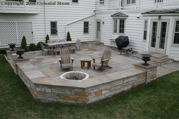 patterned bluestone patio with fond du lac dolomite sitting walls and