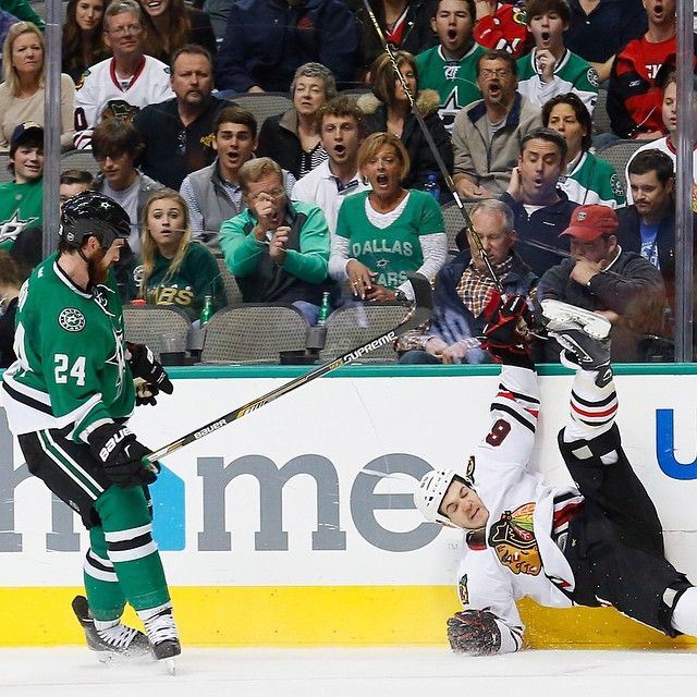 Jordie Benn (Stars) with a big hit on Andrew Shaw (Blackhawks)