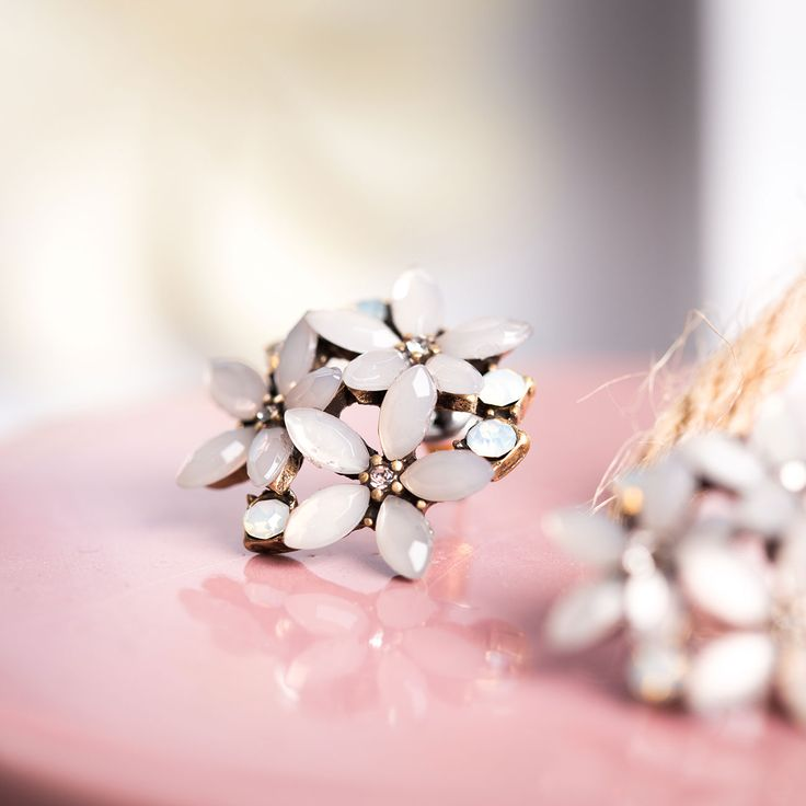 Little flower-trimmed stud earrings. <3