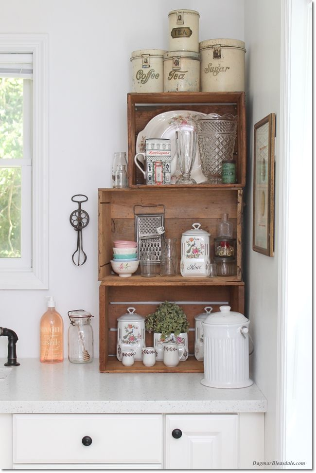 Vintage style crates used as shelves in kitchen