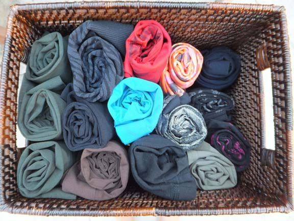 Organize socks, tights, leggings by rolling them up and securing them with a rubber band.