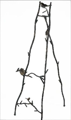 † Twig easel with birds and leaves. Interesting. This one is metal made to look like twigs, but i can make it out of twigs/branches. Large 35 in.  My question is ... wonder what I will put on it? My mind is trying to turn it into a trellis and just putting fall leaf garland, other garland, ivy vines, etc. on it ... but this is an EASEL lol.