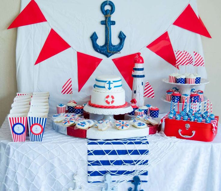 Red, white and blue dessert table at a nautical baby shower party! See more party planning ideas at CatchMyParty.com!