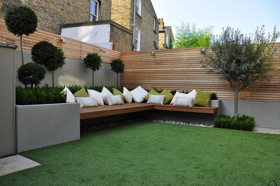 Cozy backyard seating using artificial grass. Free estimate at ParadiseGreens.com