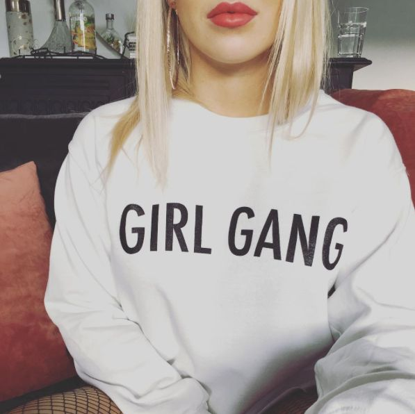 Who's your girl gang? Cropped white oversized sweater.