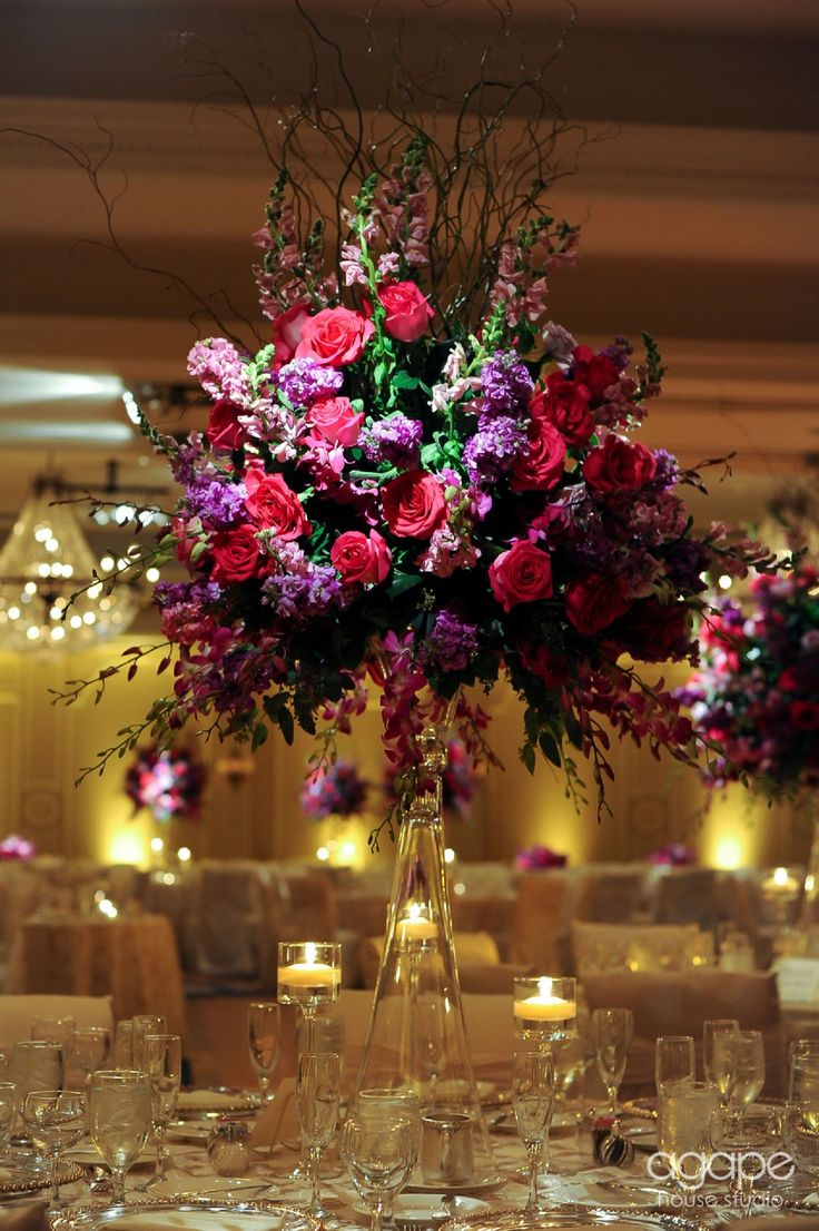 Jewel Tone Fl Centerpiece Featuring Purple And Pink Flowers See Our Wedding Inspiration