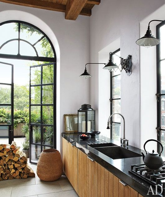 dark countertops + plank wood cabinets + dark window frames