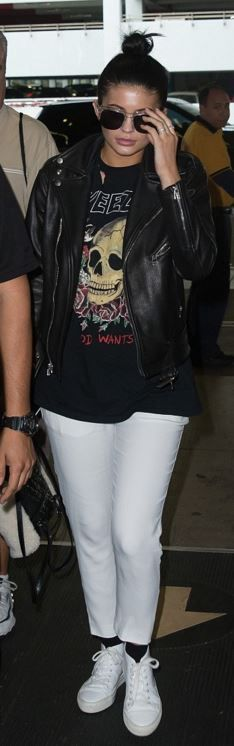 Who made Kylie Jenner's white sneakers, print tee, and leather backpack?
