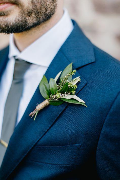 green boutonniere - http://ruffledblog.com/lush-green-wedding-with-a-boho-twist