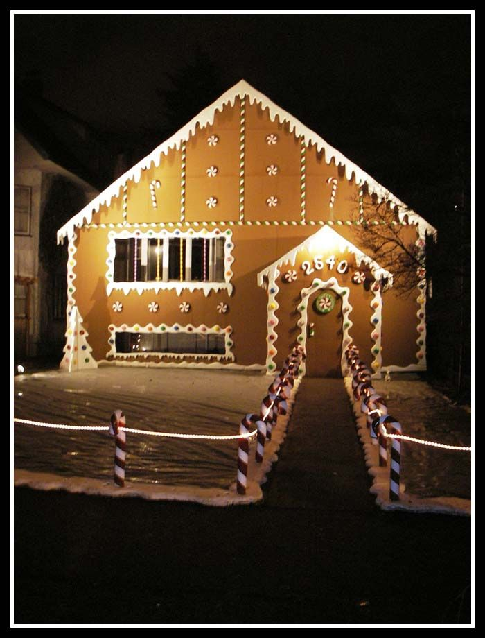 Christmas Candies(candy Canes), Lights,snow Decorated Over The House .