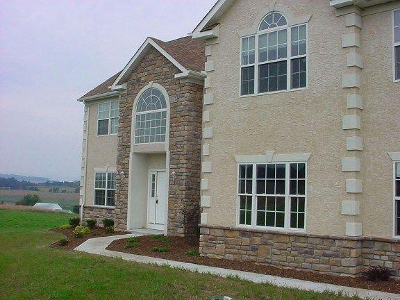 Natural Stone Siding Cost Vs Stucco And Brick Veneer Siding 2018 Siding Cost Mediterranean Homes Exterior Exterior House Siding