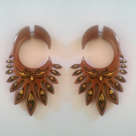 Check out this item in my Etsy shop https://www.etsy.com/listing/268379453/thorn-wings-fake-gauge-earrings-wooden