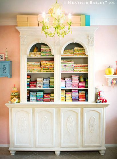 Who says sewing studios have to be plain or the furniture blah?  I love what Heather Bailey has done in her room!