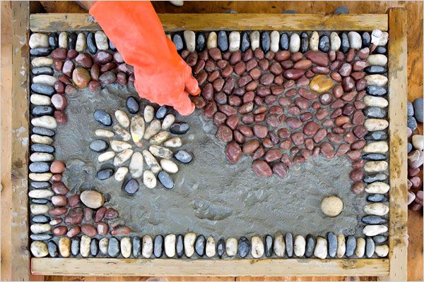 Mr. Bale's method is unorthodox. Once he finishes selecting his palette of pebbles, he fills small sections at a time, carefully pressing each stone into a slurry of concrete that sets in 20 minutes.