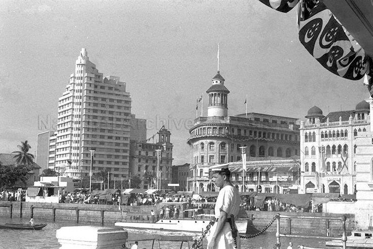 1959 - Crowd in front of Asia Insurance Building (left), Ocean Building (centre) and Arcade Building (right) watching sea sports event during National Loyalty Week