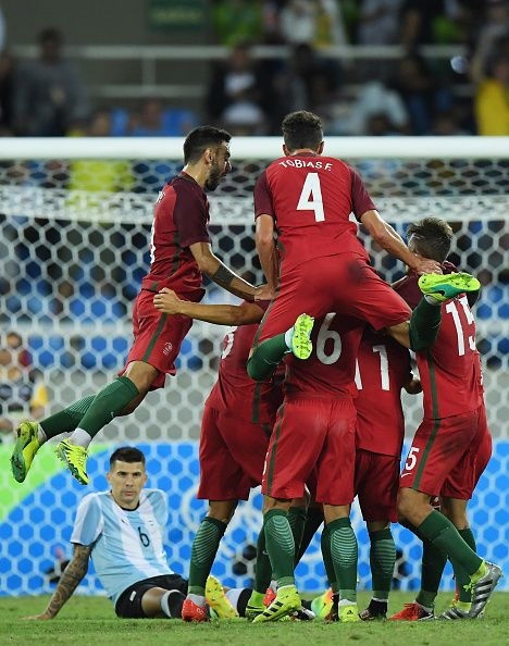 #RIO2016 Figueiredo Tobias and Tomas Martins Podstawski of Portugal celebrate with their team after scoring during the Men's Group D first round match between...