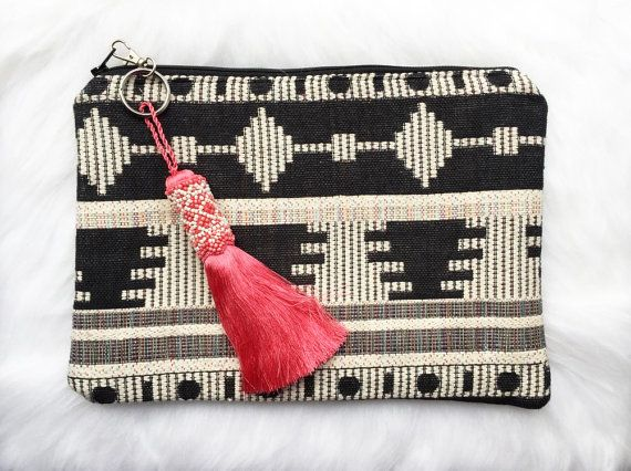 This tribal handmade clutch is both practical and colourful, perfect for everyday use. Great for storing essentials as it is big enough to fit an iPad/ tablet as the soft lining protects the screen.  Adds a colourful edge to any outfit!  Size: 20cm x 28cm