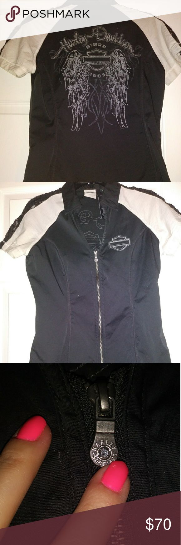 Women's harley zip up shop shirt Black and cream Harley shirt, black lace on the arm's with zippered front and rhinestones on the back. Only wore once! This is super cute and hate to get rid of it but quit riding recently. My loss is definitely your gain... Can be worn all by it's self or with cami underneath. Harley-Davidson Tops Tees - Short Sleeve