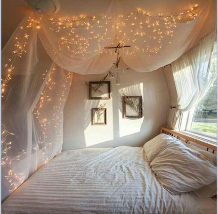bee lights and mosquito netting above the bed pretty sure this is a fire hazard bedroom. Black Bedroom Furniture Sets. Home Design Ideas